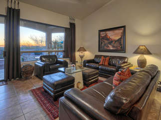 Great room has lots of comfortable seating to view beautiful landscapes and breathtaking sunsets