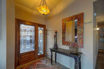 Elegant foyer welcomes you to pristine home on lake