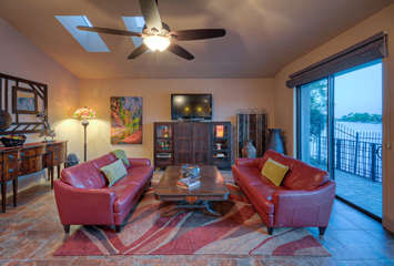 Plush seating in great room to view TV or lake activities