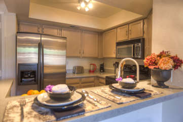 Fully stocked kitchen has recently been upgraded with granite counter tops and new stainless steel appliances