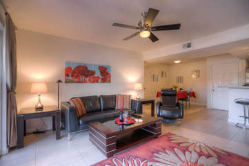 Living area is bright and cheerful and designed to be comfortable as well as stylish