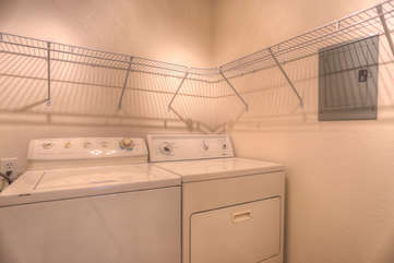 Spacious and fully stocked laundry room
