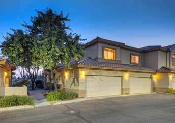 Second floor condo with attached 2 car garage in renowned gated community