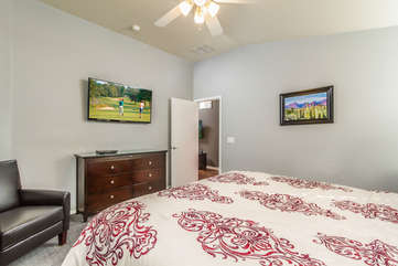 Stretch out for a nap or to watch golf tournament on large screen TV in master bedroom