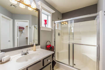 Adjacent to master bedroom is bath with walk-in shower