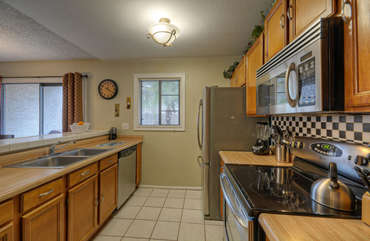 Kitchen is completely stocked and has new stainless steel appliances