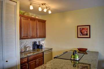 Fully-equipped kitchen with granite countertops