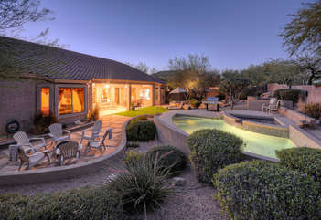 Delightful east facing backyard paradise with seating for all