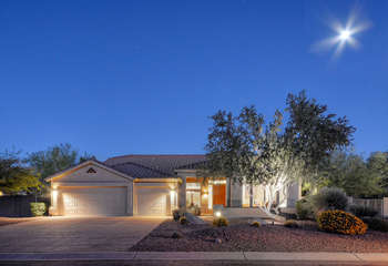 Welcome to gorgeous, one story, NE Mesa home with garage space for 2 vehicles