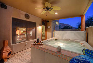 Hot tub on covered porch is perfect spot to relax and toast the good life