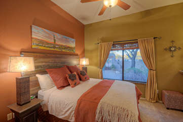 Newly renovated third bedroom features a queen bed and impressive views of luscious scenery