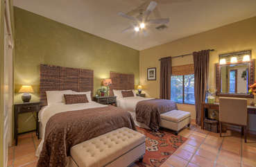 Fourth bedroom has two full beds, ample closet space and tantalizing views of outdoors