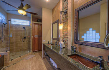 Dual vanity sinks and extra-large glass shower in sleek master bath