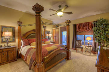 Master suite features canopy king bed  and private doors to outdoor hot tub for midnight rendezvous