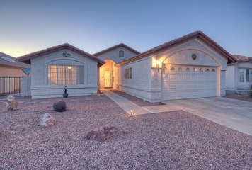 Pretty Sun Lakes home with 2 car garage is brimming with southwest charm both inside and out