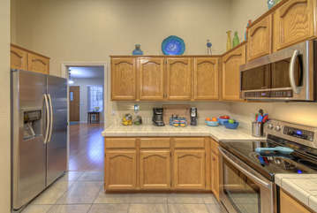 Completely stocked kitchen has everything you need to prepare and serve favorite foods and beverages