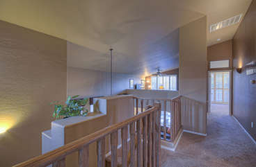 Open floor plan includes loft effect at top of stairs