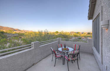 Balcony is furnished to enjoy morning coffee and evening nightcaps under sun or star lit skies, complete with golf course and mountain views.