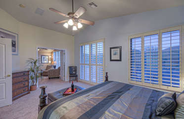 Master suite includes beautiful king bed and sliding doors to private balcony