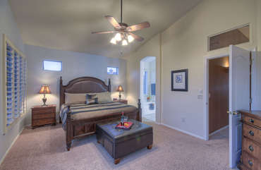 Upstairs master suite features king bed, walk-in closet and stunning sunrise views from balcony