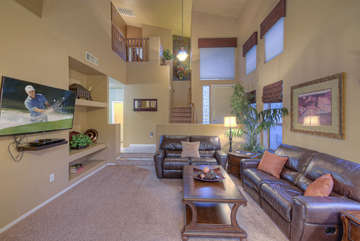 Stylish great room has plenty of comfortable seating for planning daily events or viewing recently added larger television