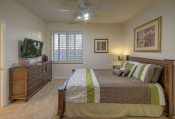 Upstairs third bedroom with queen bed shares Jack and Jill bathroom with second bedroom and TV