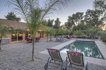 Sensational sunsets are part of the magic guests will experience at exquisite Scottsdale home with golf course views