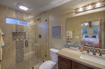 Contemporary glass and tile shower with transom window in west primary bath