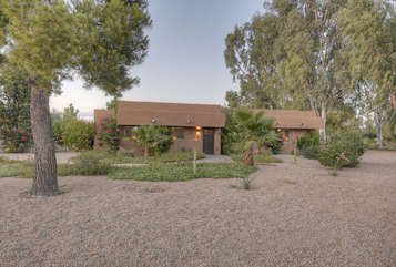 Exquisite ranch style home on large lot awaits your arrival