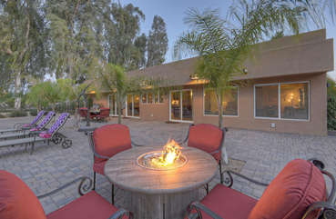 Back of house is a private oasis with resort amenities and enticing setting