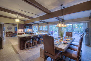Picturesque formal dining room seats 8 and offers view of backyard paradise