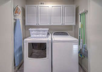 Fully stocked laundry room has new appliances to keep your wardrobe clean and ready for your next adventure