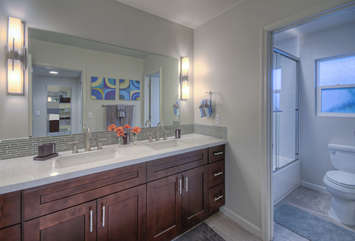Tub/shower combination and dual vanity sinks are appealing features of third bath