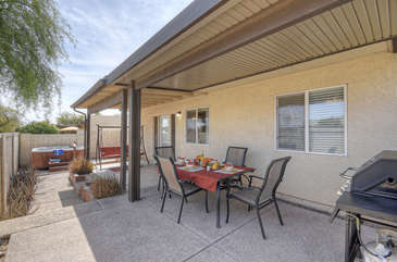 Covered patio is delightful place to enjoy the outdoors in warm and sunny Arizona