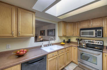Updated kitchen has new stainless steel appliances, granite counters and skylights that convey natural light to all corners