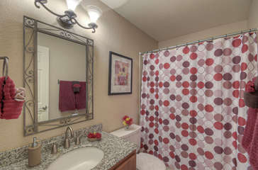 Second bath features tub/shower combination and granite vanity top