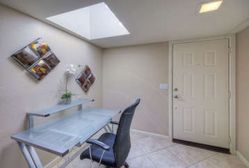 Charming entrance foyer with skylight greets you when you enter home