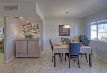 Pretty dining area seats up to 6 people and has outdoor view