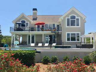 Enjoy the beautiful outdoor space with gas grill, table seating, pool!