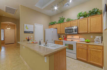 Custom kitchen has everything you need to prepare and serve delectable cuisine