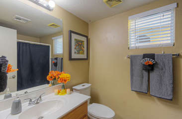 Second bath offers tub/shower combination and also has a new commode