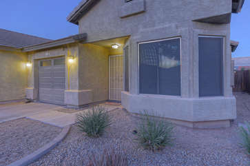 One story home with exciting new upgrades and one car garage is located in pretty and popular  Mesa neighborhood