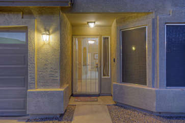 Custom and private entrance way to delightful home in quiet, gated community