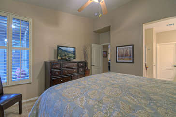 Exciting features of master bedroom include a television, walk-in closet and new tile floors