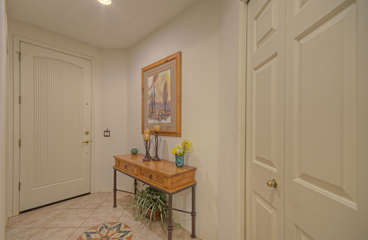 Front entry welcomes you to pretty ground floor Mesa condo in gated community