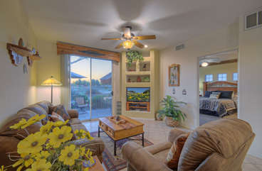 Great room has sliding doors to patio where the views of golf course and sunsets will tantalize you