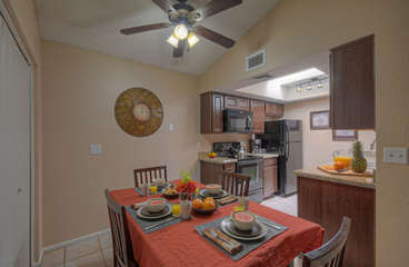 Appealing eating area off kitchen for take out from local restaurants or your favorite cuisine prepared in well stocked kitchen