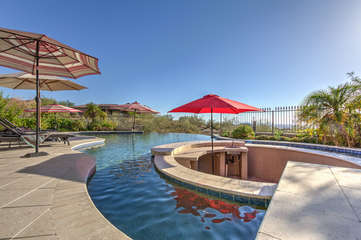 The perfect wet bar is the swim up bar with spectacular city and mountain views both day and night