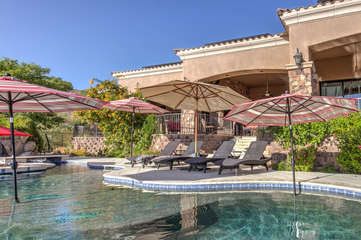 Recline in style poolside with comfortable loungers and protective umbrellas