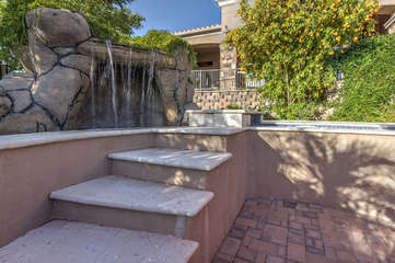 Waterfall and steps that lead to swim up bar adjacent to pool